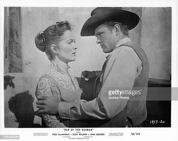Joan Weldon looking up at John Ericson in a scene from the film 'Day Of The Badman' 1958