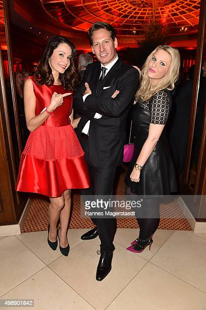 Joana Danciu Axel Ludwig and Alessandra Geissel during a christmas party at Hotel Vier Jahreszeiten Kempinski on November 26 2015 in Munich Germany