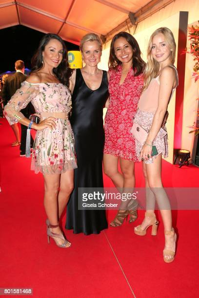 MUNICH GERMANY JUNE 26 Joana Danciu Dr Barbara Sturm Sinta Weisz and Charly Sturm during the Movie meets Media Party during the Munich Film Festival...