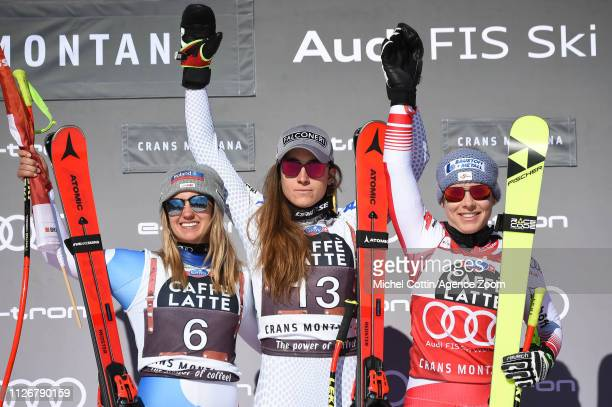 Joana Haehlen of Switzerland takes 2nd place, Sofia Goggia of Italy takes 1st place, Nicole Schmidhofer of Austria takes 3rd place during the Audi...