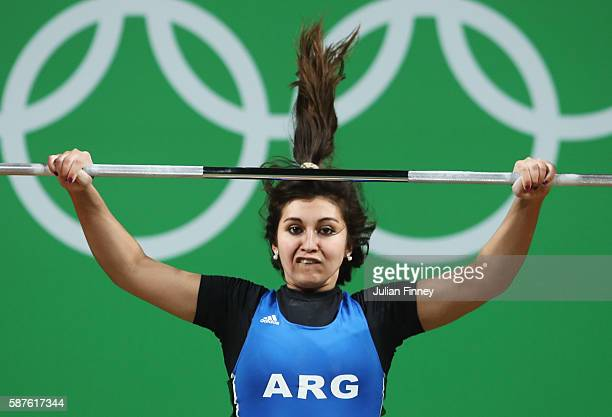 Joana Palacios of Argentina competes during the Women's 63kg Group B Weightlifting contest on Day 4 of the Rio 2016 Olympic Games at the Riocentro -...