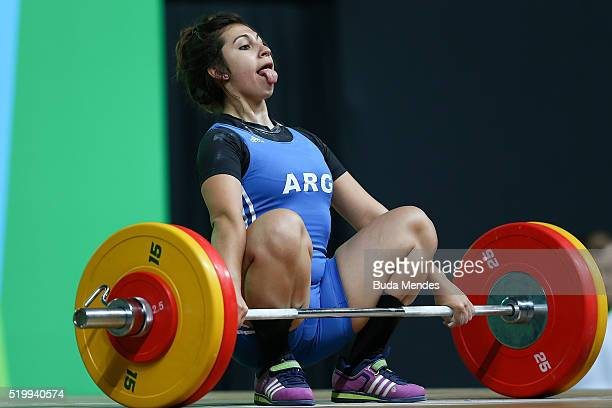 Joana Palacios of Argentina competes in the women's 63kg weightlifting competition as a test event for 2016 Rio Olympics at the Olympic Park on April...