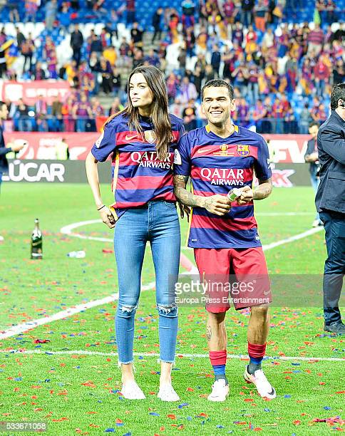 Joana Sanz and Dani Alves attend the Copa del Rey match FC Barcelona vs Sevilla FC at Vicente Calderon Stadium on May 22 2016 in Madrid Spain