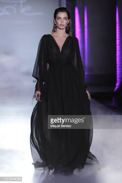 Joana Sanz walks the runway at the Maite by Lola Casademunt's new F/F 2019 collection during 080 Barcelona Fashion Week held at Recinte Moderniste...