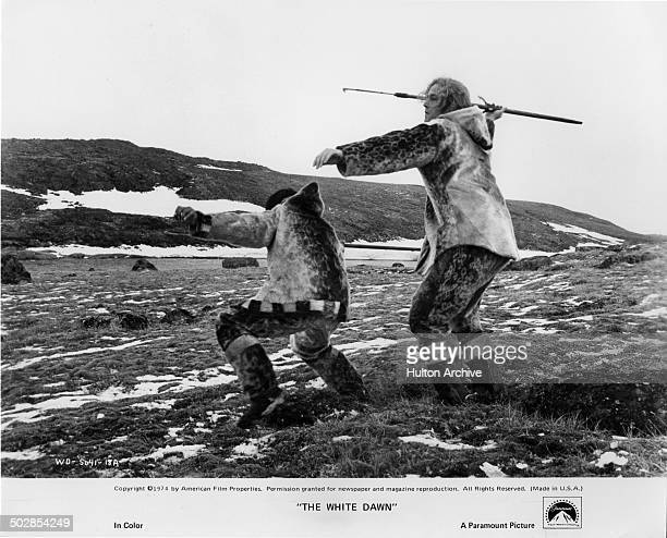 Joanasie Salamonie and Timothy Bottoms hunt in a scene from the Paramount Pictures movie The White Dawn circa 1974