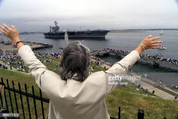 Joanie Benoit waves goodbye to the aircraft carrier USS John F Kennedy from Castle Island in South Boston on July 17 2000
