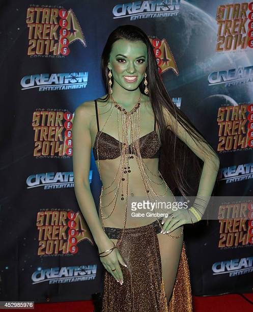 Joanie Brosas of Utah dressed as an Orion slave girl character from the Star Trek franchise attends the 13th annual Star Trek convention at the Rio...
