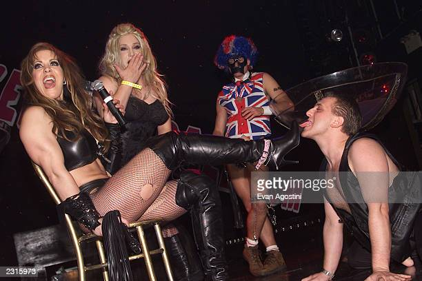Joanie Laurer finds someone to lick her boots at the Exotic Erotic Ball at Webster Hall in New York City Photo Evan Agostini/Getty Images