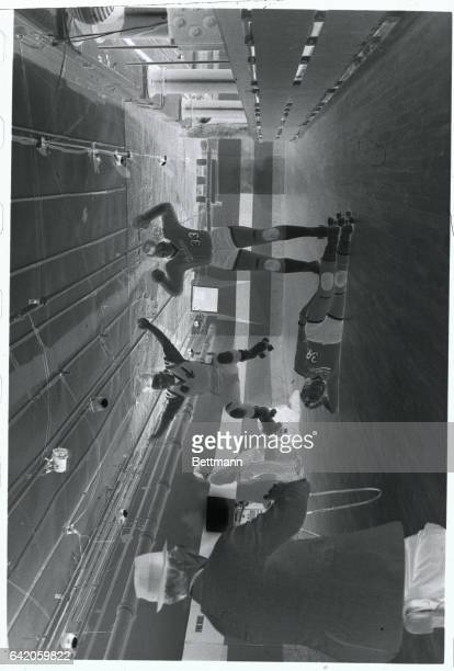 Joanie Weston roller derby player is lying on the floor here while Sue Barkley and Willi Ryan exercise at press conference in New York City The...