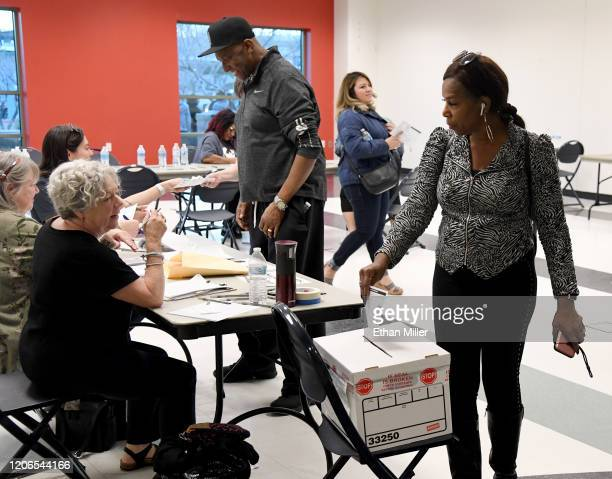 JoAnn Archie of Nevada puts her ballot in a ballot box as she votes on the first day of early voting for the upcoming Nevada Democratic presidential...