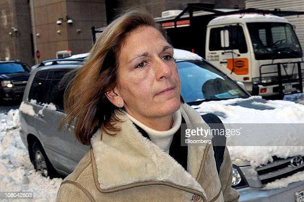 Joann Crupi a former employee of Bernard L Madoff Investment Securities LLC exits federal court in New York US on Friday Jan 14 2011 Crupi is among...