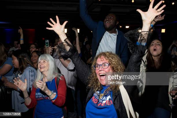 JoAnn Loulan center reacts with her motherinlaw Sydney Crawford at left after projections that Democrats gained control of the House of...