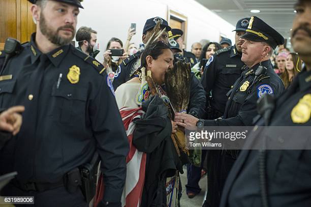 Joann Spotted Bear from Wounded Knee SD is arrested by Capitol Police after protesting the Dakota Access Pipeline outside of the Senate Environment...