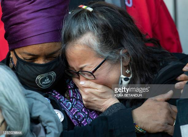 Jo-Ann Yoo, Executive Director of the Asian American Federation, cries after speaking on March 30 during an Asian American anti-violence press...
