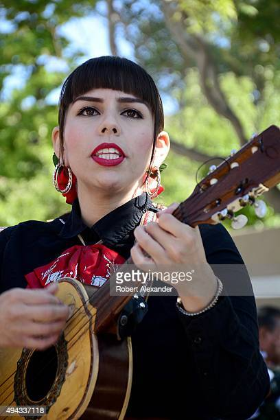 Joanna AlvarezReyes the lead vocalist and guitarist for the allfemale mariachi band Mariachi Buenaventura performs in the small SpanishAmerican town...