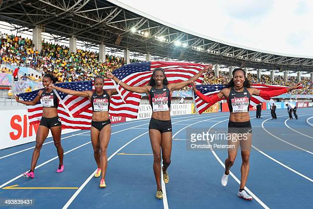Joanna Atkins Natasha Hastings Deedee Trotter and Sanya RichardsRoss of the United States round the track in celebration after winning the Women's...
