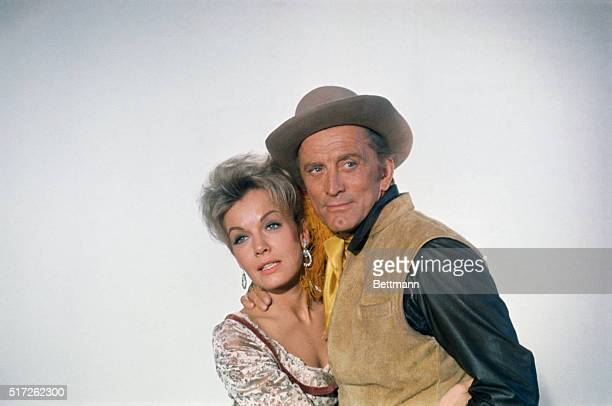 Joanna Barnes and Kirk Douglas in costume for the motion picture The War Wagon