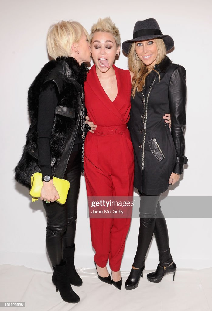 Joanna Coles, editor-in-chief of Marie Claire magazine, Miley Cyrus and Tish Cyrus attend Rachel Zoe during Fall 2013 Mercedes-Benz Fashion Week at The Studio at Lincoln Center on February 13, 2013 in New York City.