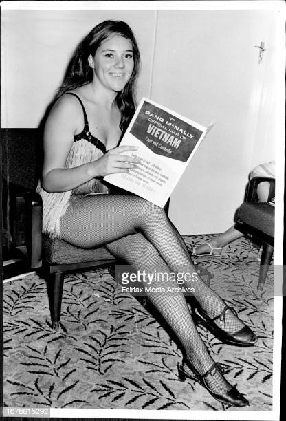 Joanna Dick, 18 years old Go-Go Dancer, Packing her suitcase, to prepare for her Three Months Tour of South Vietnam. April 04, 1967. .