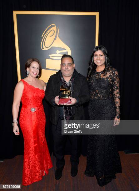 Joanna Egozcue Carlos R Perez and Roxy Quinones pose with the award for Best Short Form Music Video for Despacito at the Premiere Ceremony during the...