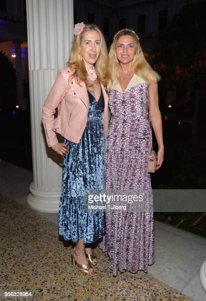 Joanna Garzilli and Evgenia Lorcy attend BritWeek at The Getty Villa on May 8 2018 in Pacific Palisades California