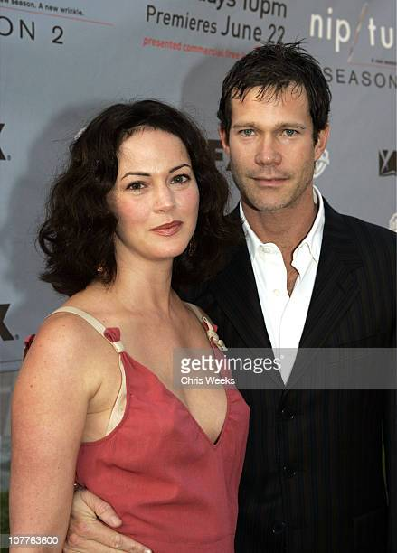 Joanna Going and Dylan Walsh during Nip/Tuck Season 2 Premiere Red Carpet at Paramount Theatre in Los Angeles California United States