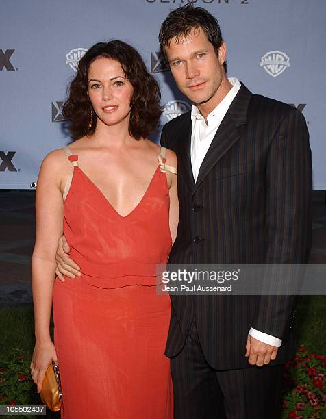 Joanna Going and Dylan Walsh during Nip/Tuck Season Two Premiere Arrivals at Paramount Theatre in Los Angeles California United States