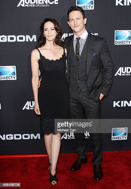Joanna Going and Jonathan Tucker arrive at the Los Angeles premiere of Kingdom held at Muscle Beach on October 1 2014 in Venice California