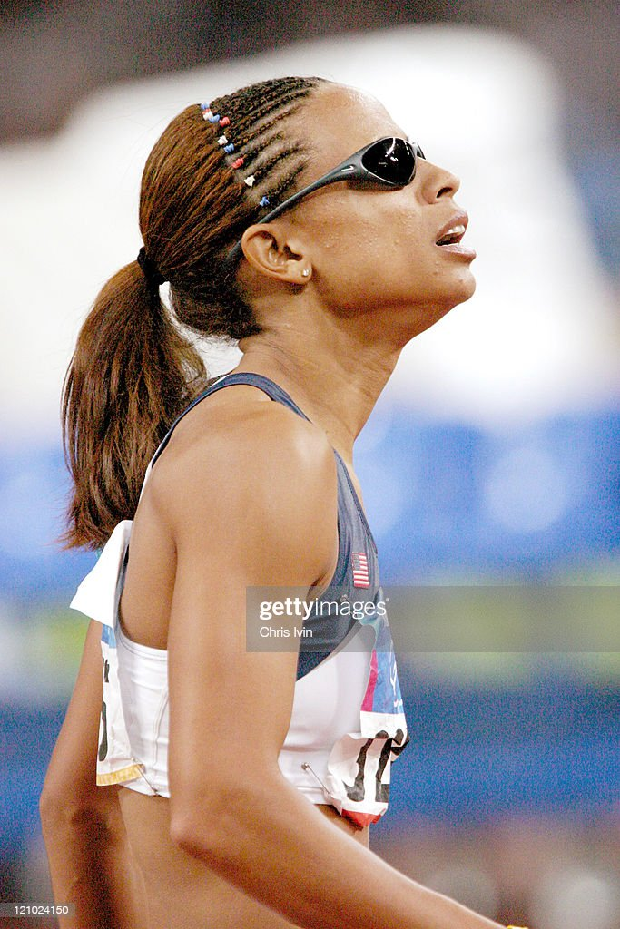 Joanna Hayes of the United States wins the Women's 100m Hurdles during the Athens 2004 Olympic Games in Athens, Greece on August 24, 2004 with a new Olympic record time of 12.37