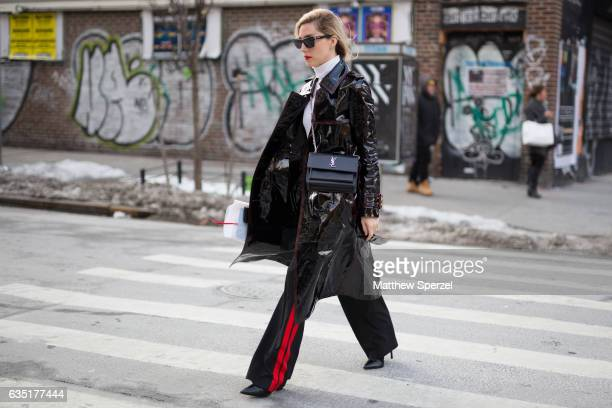 Joanna Hillman is seen attending The Row during New York Fashion Week wearing a black jacket with black and red striped pants on February 13 2017 in...
