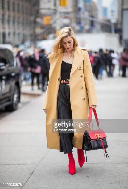 Joanna Hillman is seen wearing beige trench coat, black pleated skirt outside Zimmermann during New York Fashion Week Autumn Winter 2019 on February...