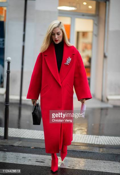 Joanna Hillman is seen wearing red coat Balenciaga bag outside Maison Margiela during Paris Fashion Week Haute Couture Spring Summer 2019 on January...