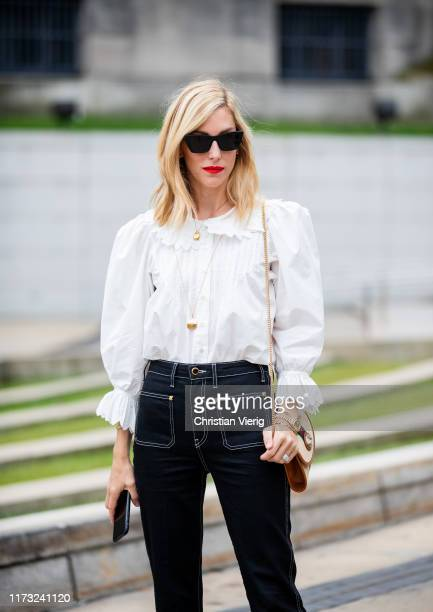 Joanna Hillman is seen wearing white blouse dark denim jeans outside Tory Burch during New York Fashion Week September 2019 on September 08 2019 in...