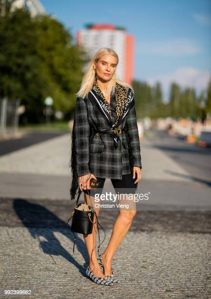Joanna Horodynska wearing biker pants plaid jacket bucket bag Balenciaga scarf is seen outside Dawid Tomaszewski during the Berlin Fashion Week July...