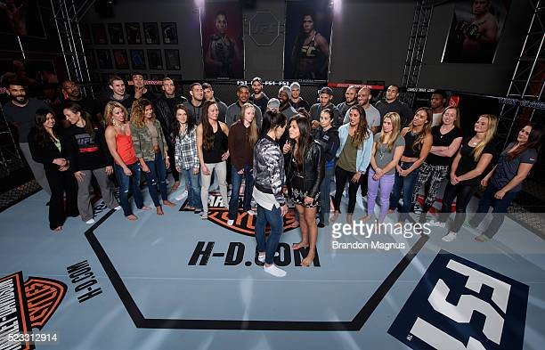 Joanna Jedrzejczyk and Claudia Gadelha face off while fighters pose for a portrait at the UFC TUF Gym on January 25 2016 in Las Vegas Nevada