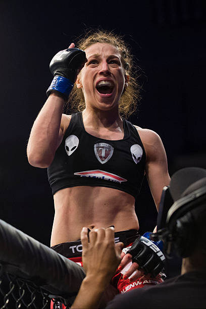 Joanna Jedrzejczyk celebrates after defeating Carla...