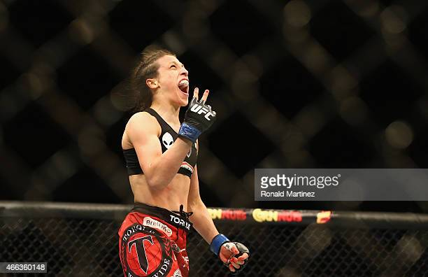 Joanna Jedrzejczyk celebrates her TKO against Carla Esparza in the Women's Strawweight bout during the UFC 185 event at American Airlines Center on...