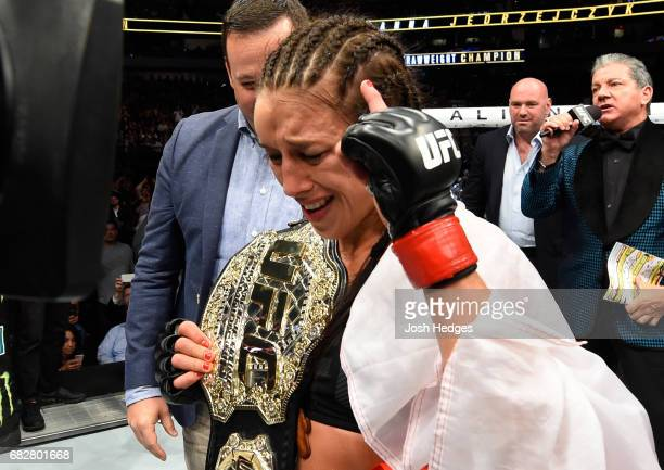 Joanna Jedrzejczyk celebrates her victory over Jessica Andrade in their UFC women's strawweight championship fight during the UFC 211 event at the...