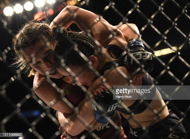 Joanna Jedrzejczyk hangs on to Weili Zhang in her split decision loss during a strawweight title bout at TMobile Arena on March 07 2020 in Las Vegas...