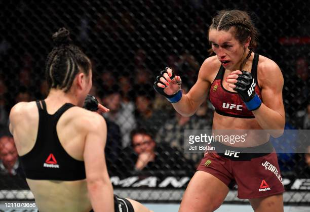 Joanna Jedrzejczyk of Polan battles Zhang Weili of China in their UFC strawweight championship fight during the UFC 248 event at TMobile Arena on...