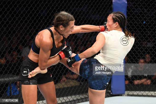 Joanna Jedrzejczyk of Poland and Michelle Waterson exchange strikes in their women's strawweight bout during the UFC Fight Night event at Amalie...