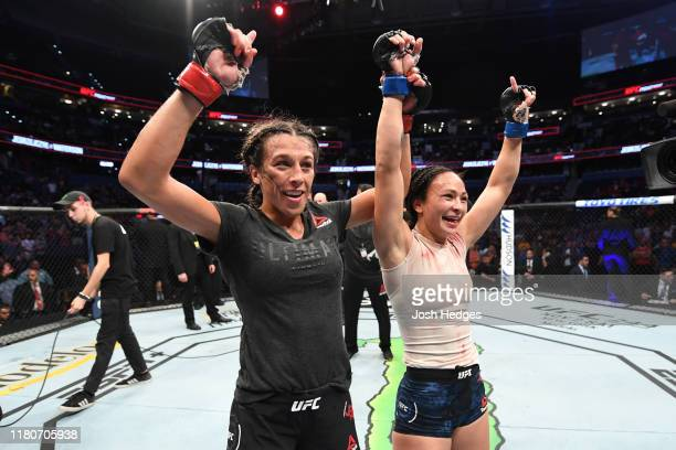 Joanna Jedrzejczyk of Poland and Michelle Waterson react after the conclusion of their women's strawweight bout during the UFC Fight Night event at...