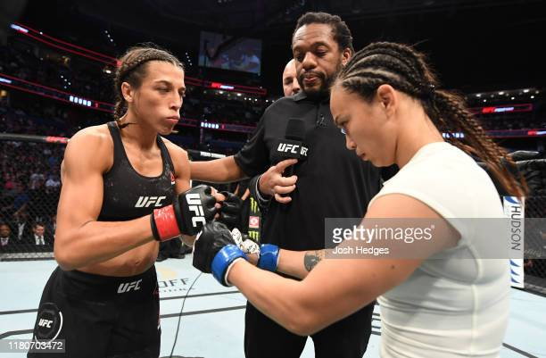 Joanna Jedrzejczyk of Poland and Michelle Waterson touch gloves prior to their women's strawweight bout during the UFC Fight Night event at Amalie...