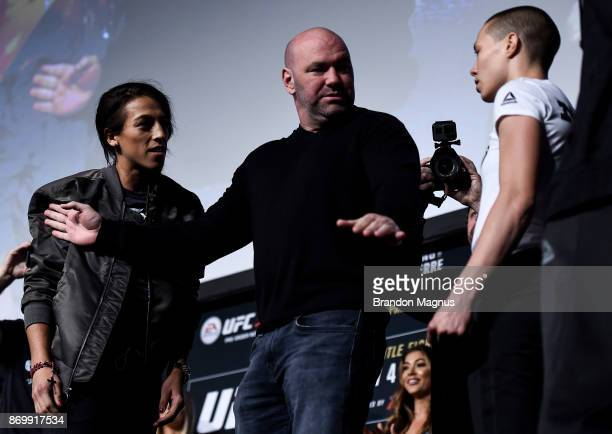 Joanna Jedrzejczyk of Poland and Rose Namajunas face off during the UFC 217 weigh-in inside Madison Square Garden on November 3, 2017 in New York...