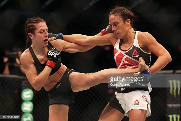 Joanna Jedrzejczyk of Poland and Valerie Letourneau of Canada compete in their UFC women's strawweight championship bout during the UFC 193 event at...