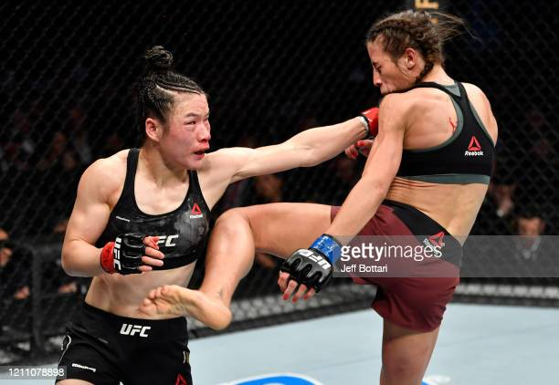 Joanna Jedrzejczyk of Poland and Zhang Weili of China trade strikes in their UFC strawweight championship fight during the UFC 248 event at TMobile...