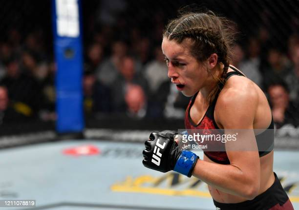 Joanna Jedrzejczyk of Poland battles Zhang Weili in their UFC strawweight championship fight during the UFC 248 event at TMobile Arena on March 07...