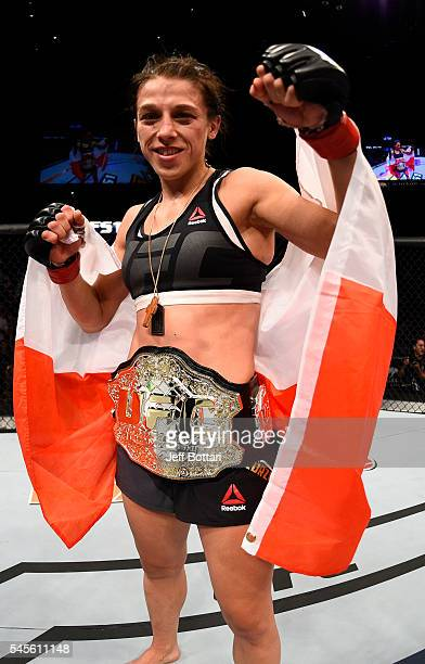 Joanna Jedrzejczyk of Poland celebrates after her decision victory over Claudia Gadelha of Brazil in their women's strawweight championship bout...