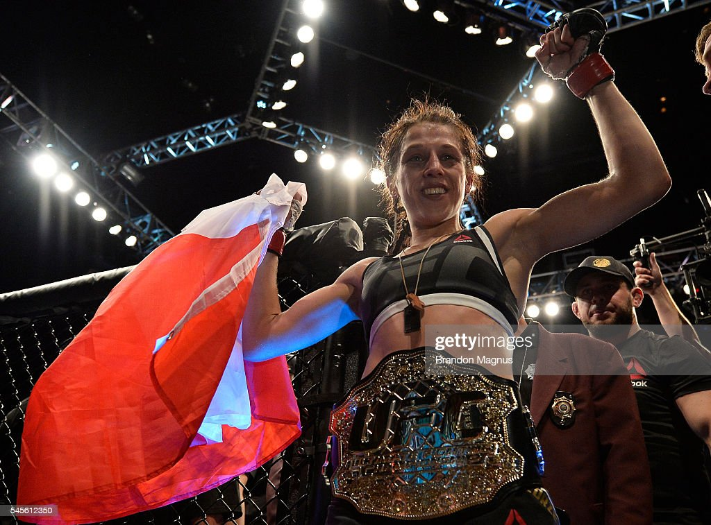 Joanna Jedrzejczyk of Poland celebrates after her victory over Claudia Gadelha in their women's strawweight championship bout during The Ultimate Fighter Finale event at MGM Grand Garden Arena on July 8, 2016 in Las Vegas, Nevada.