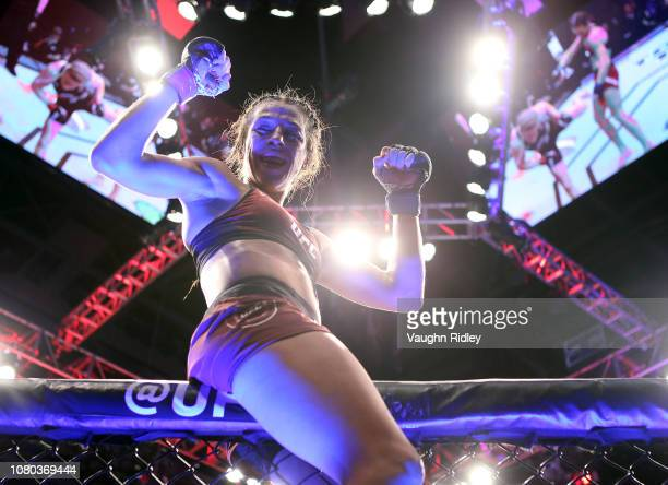 Joanna Jedrzejczyk of Poland celebrates following her fight against Valentina Shevchenko of Kyrgyzstan in a flyweight bout during the UFC 231 event...